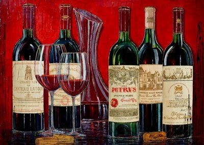 Tableau de bouteilles de grands vins bordelais avec carafe à décanter et verre de vin