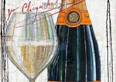 Bouteille de champagne Veuve Clicquot avec une verre rempli de champagne